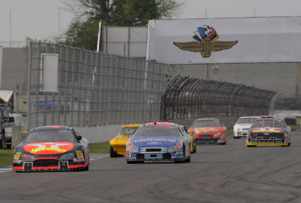 6-8 June, 2014, Indianapolis, Indiana, USA #42 2005 Dodge Charger followed by field of NASCAR cars ?2014 Dan R. Boyd LAT Photo USA