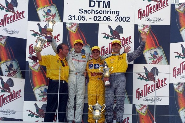 Podium and results:1st: Laurent Aiello (FRA) Audi, centre2nd: Bernd Schneider (GER) Mercedes, left3rd: Alain Menu (SUI) Opel, right.German Touring Car Championship, Sachsenring, Germany, 2 June 2002DIGITAL IMAGE