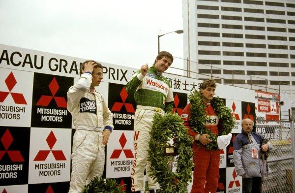 The podium (L to R): Jan Lammers (NED) second; Martin Donnelly (GBR) winner; Bernd Schneider (GER) third.International Formula Three, Macau Grand Prix, Hong Kong, 29 November 1987.