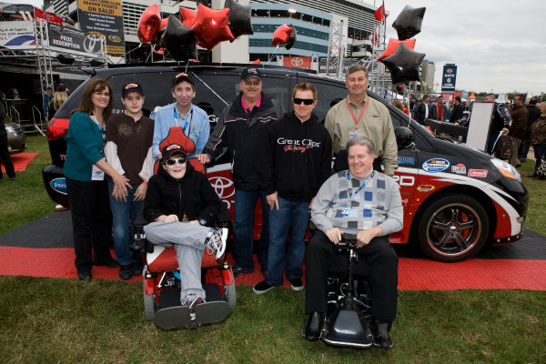 15-16 October, 2009, Concord, North Carolina, USAKody Harlow, winner of the Toyota Mobility/Braun Ultimate fan van giveaway with driver Jason Leffler, Ralph Braun, Greg Glander from Toyota Mobility and family©2009, Michael L. Levitt, USALAT Photographic