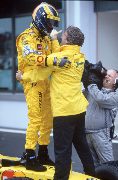 1999 French Grand Prix. Magny-Cours, France. 25-27 June 1999. Heinz-Harald Frentzen (Jordan Mugen Honda) celebrates his 1st position with team boss Eddie Jordan . World Copyright - Steven Tee/LAT Photographic Ref:35mm Image 99 FRA 03