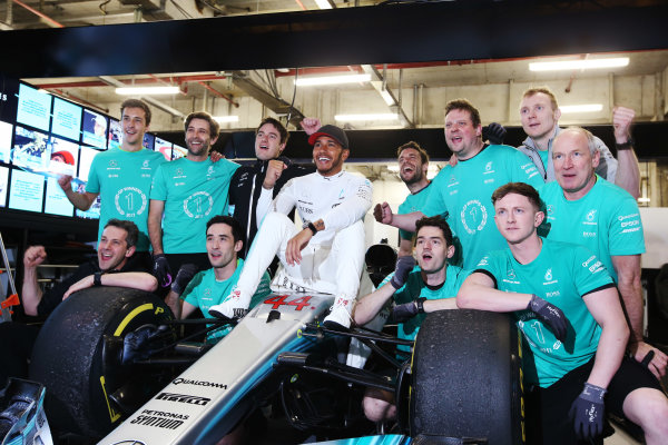 Shanghai International Circuit, Shanghai, China.  Sunday 09 April 2017.  Lewis Hamilton, Mercedes AMG, celebrates victory with colleagues, sitting on his car. World Copyright: Charles Coates/LAT Images  ref: Digital Image AN7T0991