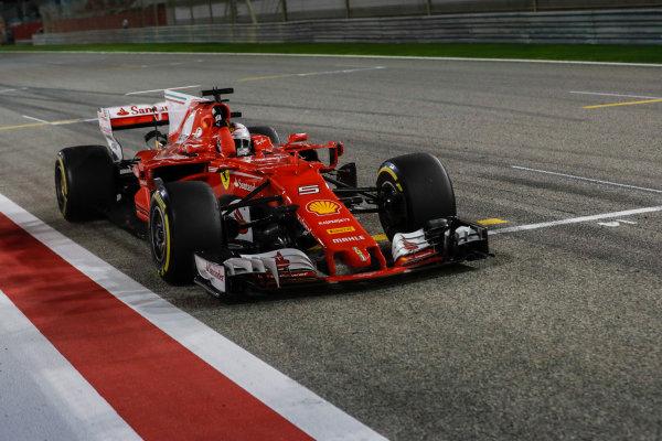 Bahrain International Circuit, Sakhir, Bahrain.  Sunday 16 April 2017. Sebastian Vettel, Ferrari SF70H, 1st Position, celebrates after crossing the finish line. World Copyright: Charles Coates/LAT Images ref: Digital Image _27I0754