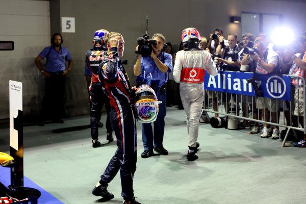 Marina Bay Circuit, Singapore.25th September 2011.Sebastian Vettel, Red Bull Racing RB7 Renault, 1st position, celebrates on his way to the podium. Portrait. Finish. World Copyright:Glenn Dunbar/LAT Photographicref: Digital Image IMG_1719