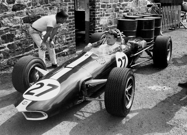 Spa-Francorchamps, Belgium. 12 June 1966.Dan Gurney, Eagle AAR101-Climax, not classified, in the paddock, with Len Terry looking on, portrait.World Copyright: LAT PhotographicRef: B/W Print