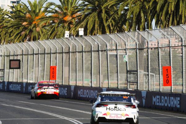 Fabian Coulthard, DJR Team Penske Ford, leads Shane van Gisbergen, Triple Eight Race Engineering Holden.