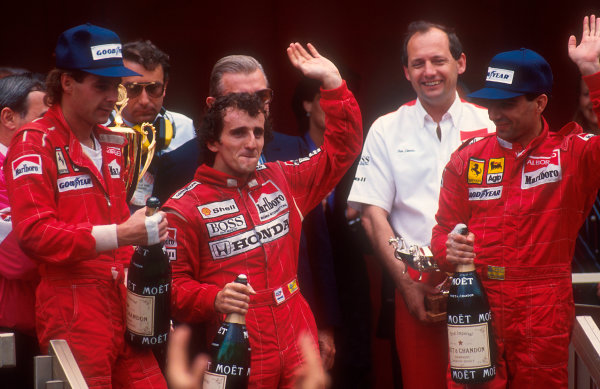 1988 Monaco Grand Prix.Monte Carlo, Monaco.13-15 May 1988.Alain Prost (McLaren Honda) 1st position, Gerhard Berger (Ferrari) 2nd position and Michele Alboreto (Ferrari) 3rd position on the podium. McLaren team boss Ron Dennis stands behind. Ref: 88MON56. World Copyright - LAT Photographic