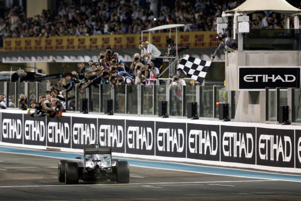 Race winner Nico Rosberg (GER) Mercedes AMG F1 W06 takes the chequered flag at Formula One World Championship, Rd19, Abu Dhabi Grand Prix, Race, Yas Marina Circuit, Abu Dhabi, UAE, Sunday 29 November 2015.