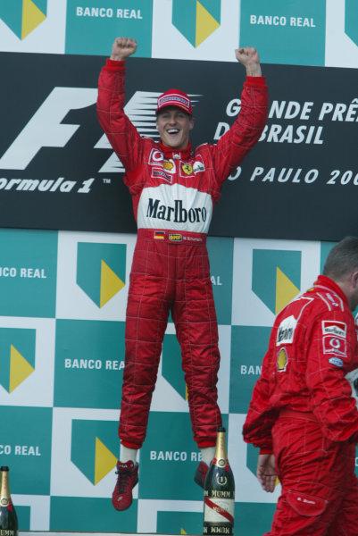 2002 Brazilian Grand Prix - RaceInterlagos, Brazil. 31 March 2002Race winner Michael Schumacher, Ferrari F2002, leaps in the air.World Copyright: Pic Steve Etherington/LAT PhotographicRef: 12 5mb Digital Image Only
