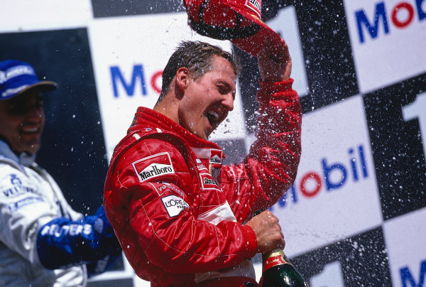 2002 German Grand Prix.Hockenheim, Germany. 26-28 July 2002.Michael Schumacher (Ferrari) celebrates his 1st position on the podium.Ref-02 GER 37.World Copyright - LAT Photographic