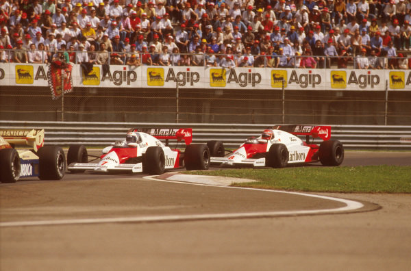 Imola, Italy.4-5 May 1984.Alain Prost (McLaren MP4\2 TAG Porsche) 1st position, racing closely with teammate Niki Lauda.Ref-84 SM 04.World Copyright - LAT Photographic