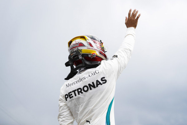 Lewis Hamilton, Mercedes AMG F1, waves after setting pole position.