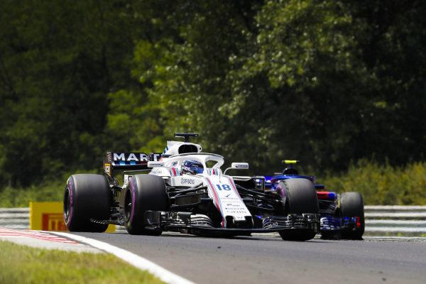 Lance Stroll, Williams FW41 Mercedes, leads Pierre Gasly, Toro Rosso STR13 Honda.