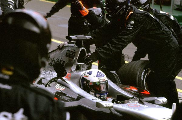 Australian Grand Prix.Albert Park, Melbourne, Australia. 2-4 March 2001.David Coulthard (McLaren MP4/16 Mercedes) during a pitstop.World Copyright - Steven Tee/LAT Photographic ref: 35mm Image Aus A22