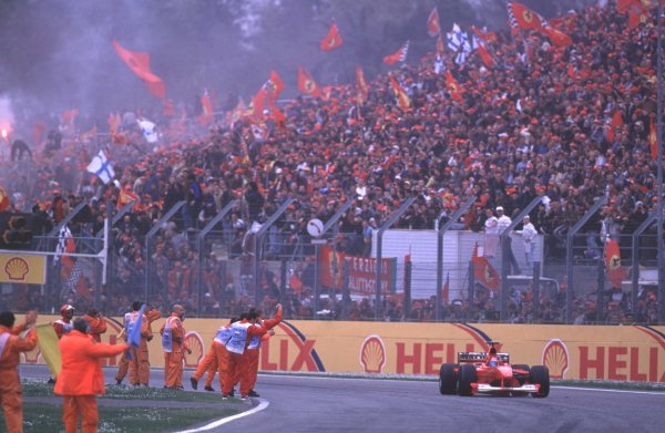 2000 San Marino Grand Prix.Imola, Italy. 7-9 April 2000.Michael Schumacher (Ferrari F1-2000) celebrates his 1st position, after taking his third win out of three races in front of the Tifosi.Format: 35mm TransparencyWorld Copyright - LAT Photographic