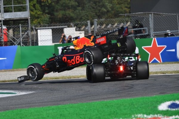 Max Verstappen, Red Bull Racing RB16B, and Sir Lewis Hamilton, Mercedes W12, crash out