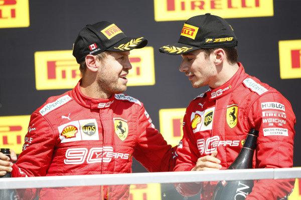Sebastian Vettel, Ferrari, 2nd position, and Charles Leclerc, Ferrari, 3rd position, on the podium