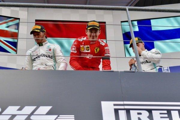 Lewis Hamilton, Mercedes AMG F1, 2nd position, Charles Leclerc, Ferrari, 1st position, and Valtteri Bottas, Mercedes AMG F1, 3rd position, on the podium