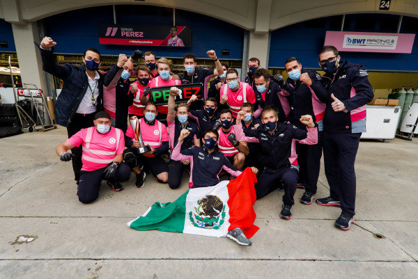 Sergio Perez, Racing Point, 2nd position, and the Racing Point team celebrate after the race