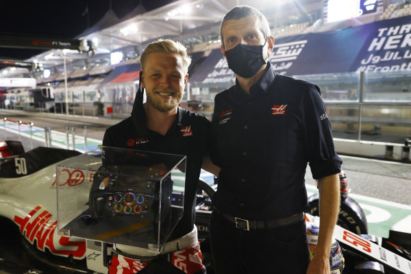 The Haas team make a presentation to Kevin Magnussen, Haas F1, ahead of his last race The Haas team make a presentation to Kevin Magnussen, Haas F1, ahead of his last race. Guenther Steiner, Team Principal, Haas F1, gifts Magnussen a Formula 1 steering wheel