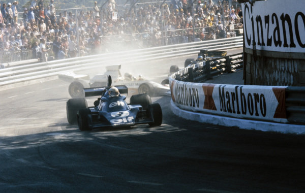 Jody Scheckter, Tyrrell 007 Ford ahead of a spinning Mike Hailwood, McLaren M23 Ford who block Ronnie Peterson, Lotus 72E Ford.