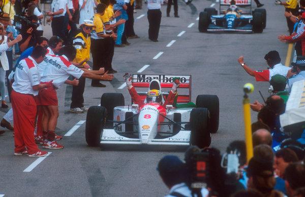 1993 Australian Grand Prix.Adelaide, Australia. 5-7 November 1993.Ayrton Senna (McLaren MP4/8 Ford) celebrates 1st position on the way down the pit lane to parc ferme. This was his last Grand Prix win. Ref-93 AUS 38.World Copyright - Martyn Elford/LAT Photographic