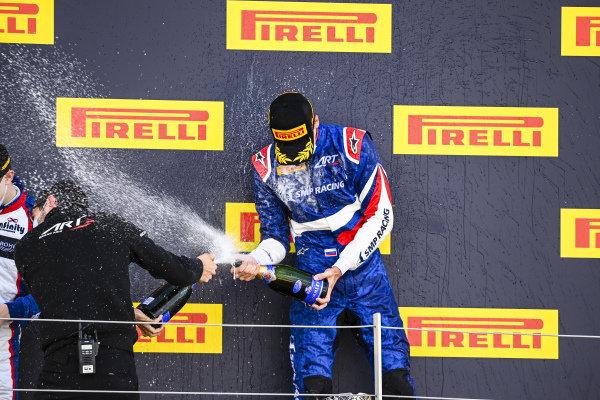 Race Winner Alexander Smolvar (RUS, ART GRAND PRIX) celebrates on the podium with the champagne