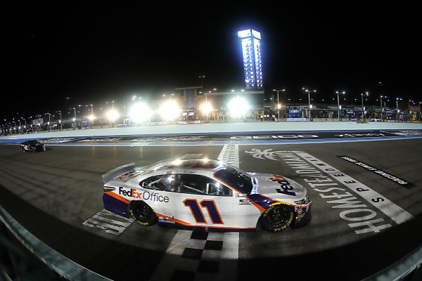 Denny Hamlin, Joe Gibbs Racing Toyota, cross the finish line, Copyright: Michael Reaves/Getty Images.