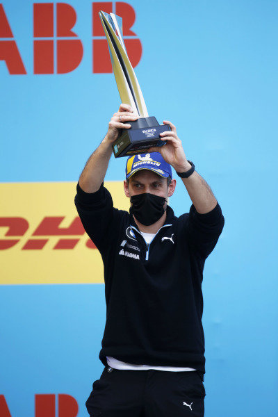 The BMW I Andretti Motorsport podium delegate with the teams trophy
