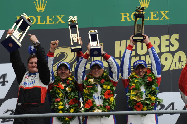 Circuit de La Sarthe, Le Mans, France. 21st-23rd June 2013. Raymond Narac/Christophe Bourrett/Jean-Karl Vernay, Imsa Performance Matmut, No. 76 Porsche 911 GT3-RSR, celebrate GTE Am Class Win. Podium. World Copyright: Jeff Bloxham/LAT Photographic ref: Digital Image DSC_9811