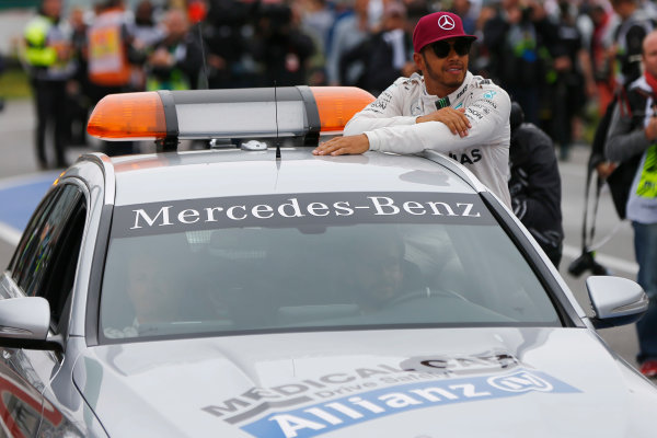Circuit Gilles Villeneuve, Montreal, Canada. Saturday 11 June 2016. Pole man Lewis Hamilton, Mercedes AMG, gets a lift in the medical car. World Copyright: Andy Hone/LAT Photographic ref: Digital Image _ONZ0615