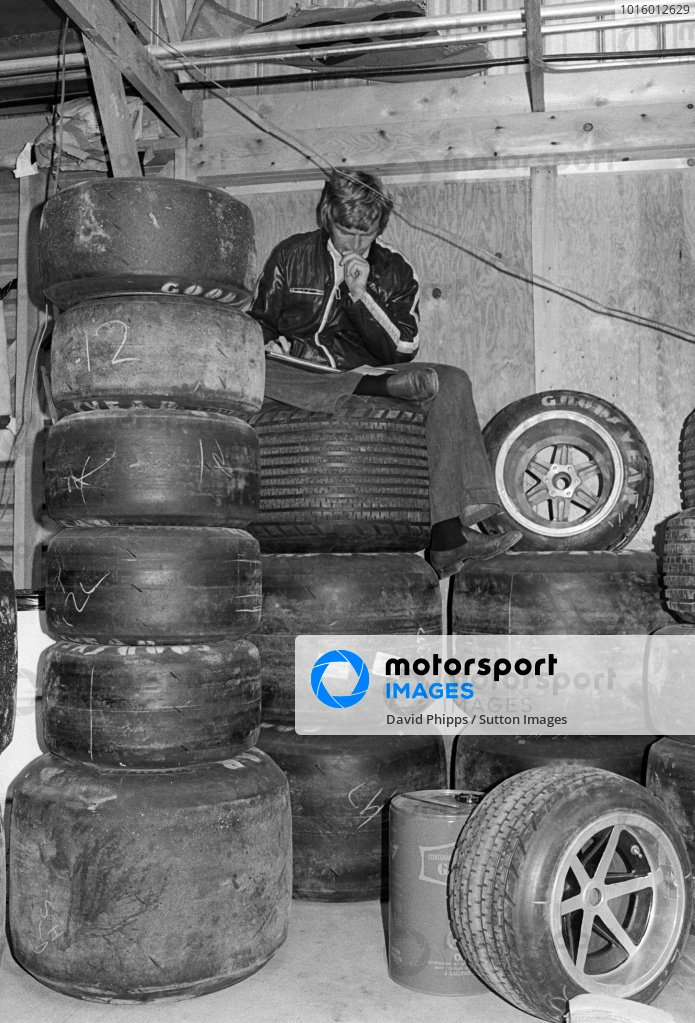 Max Mosley (GBR) March Team Owner looks over some paperwork on a stack of tyres in the communal garage area. Canadian Grand Prix, Rd 14, Mosport Park, 22 September 1974.