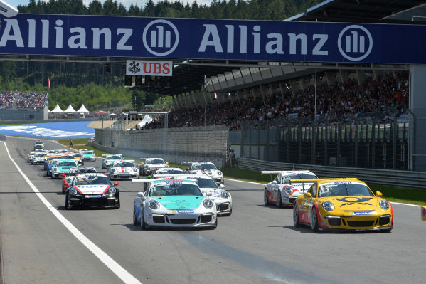 Sven Muller (GER) Team Project and Christian Engelhart (GER) lead the field at the start of the race. Porsche Supercup, Rd3, Spielberg, Austria, Sunday 21-22 June 2014.