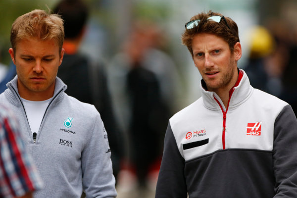 Sochi Autodrom, Sochi, Russia. Friday 29 April 2016. Nico Rosberg, Mercedes AMG, with Romain Grosjean, Haas F1. World Copyright: Andy Hone/LAT Photographic ref: Digital Image _ONY7526