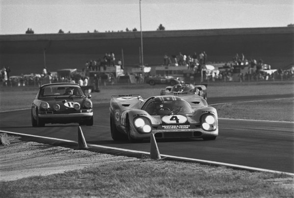 1971 Daytona 24 Hours. Daytona, Florida, USA. 30th - 31st January 1971. Rd 2. Vic Elford / Gijs van Lennep (Porsche 917K), retired, leads Peter Kirill / Ash Tisdelle (Porsche 911 S), retired, action.  World Copyright: LAT Photographic. Ref: 3494 - 22A.