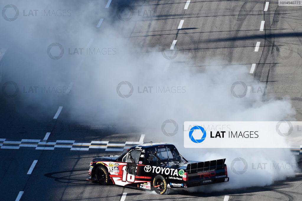 1-2 April, 2016, Martinsville, Virginia USA Kyle Busch (18) does a burnout after winning. ©2016, John Harrelson / LAT Photo USA
