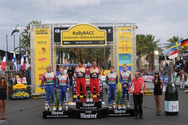 Top 3 crews on the podium.1st Sebastien Loeb (FRA), Citroen, centre.2nd Mikko Hirvonen (FIN), Ford, left.3rd Jari-Matti Latvala (FIN), Ford, right.FIA World Rally Championship, Rd12 Rally Catalunya, Salou, Spain, Day Three, Sunday 23 October 2011.