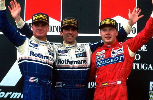 L to R: David Coulthard 2nd, Winner Damon Hill and Mika Hakkinen 3rd