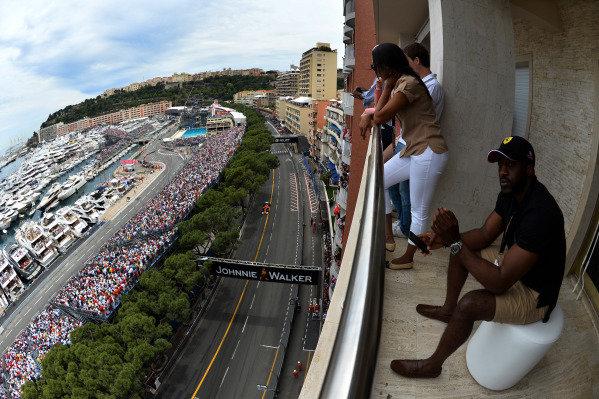 fans watch Kimi Raikkonen (FIN) Ferrari F139 drive past. Formula One World Championship, Rd6, Monaco Grand Prix, Race, Monte-Carlo, Monaco, Sunday 25 May 2014.