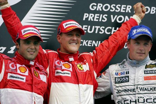 2006 German Grand Prix - Sunday Race Hockenheim, Germany. 27th - 30th July. Michael Schumacher (1st position), and Felipe Massa (2nd position) of Ferrari celebrate on the podium with Kimi Raikkonen (3rd position) of McLaren-Mercedes. World Copyright: Lorenzo Bellanca/LAT Photographic ref: Digital Image ZD2J2138