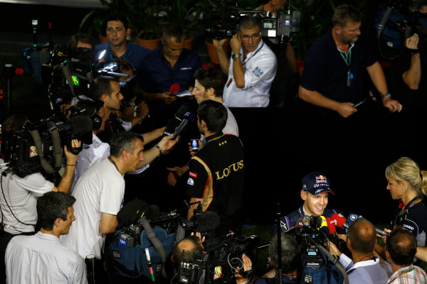 Marina Bay Circuit, Singapore. Saturday 21st September 2013.  Sebastian Vettel, Red Bull Racing, and Romain Grosjean, Lotus F1, talk to the media after qualifying.  World Copyright: Charles Coates/LAT Photographic. ref: Digital Image _N7T5481