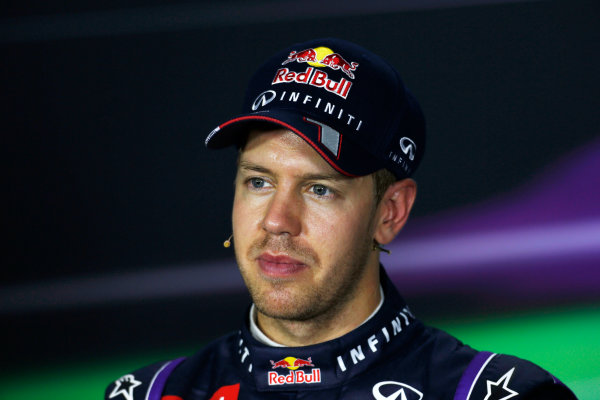 Marina Bay Circuit, Singapore. Saturday 21st September 2013.  Sebastian Vettel, Red Bull Racing, in the press conference after qualifying.  World Copyright: Charles Coates/LAT Photographic. ref: Digital Image _N7T5350