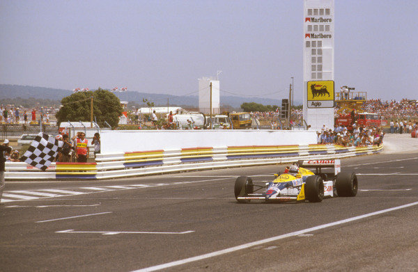 1987 French Grand Prix. Paul Ricard, Le Castellet, France. 3-5 July 1987. Nigel Mansell (Williams FW11B Honda) 1st position takes the chequered flag. Ref-87 FRA 09. World Copyright - LAT Photographic