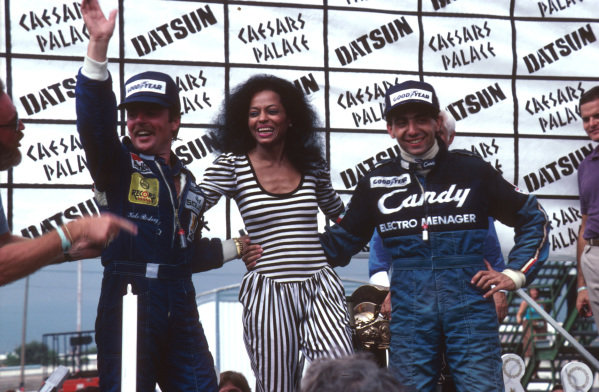 Las Vegas, Nevada, USA.23-25 September 1982.Michele Alboreto (Tyrrell Ford) 1st position with the new World Champion Keke Rosberg and singer Diana Ross on the podium.Ref-82 LV 02.World Copyright - LAT Photographic