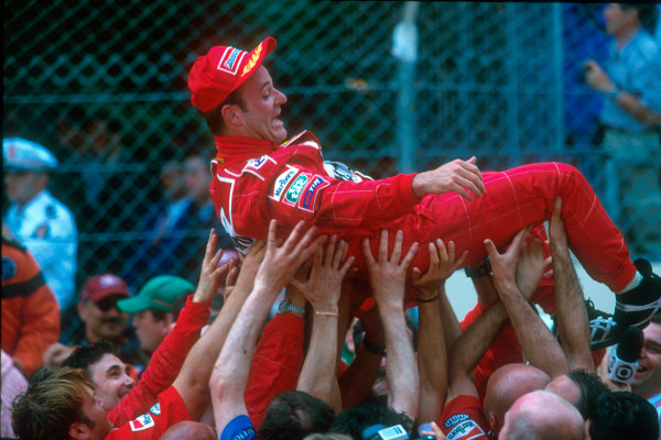 Monte Carlo, Monaco. 29th May 2001. Rubens Barrichello is lifted over his team as the Ferrari crew celebrate his 2nd place finish.World Copyright: Martyn Elford/LAT Photographic ref: 35mm Priority Image 01MON24