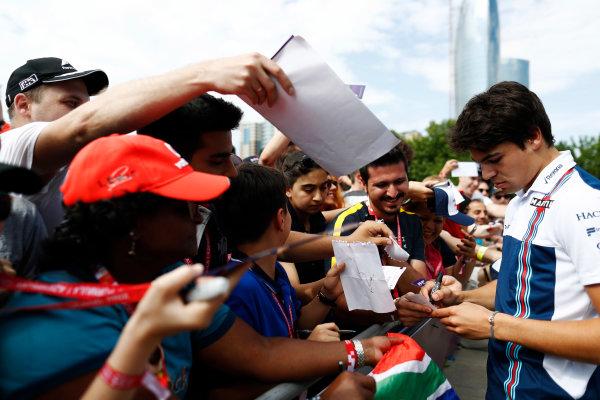 Baku City Circuit, Baku, Azerbaijan. Friday 23 June 2017. Lance Stroll, Williams Martini Racing, signs autographs for fans. World Copyright: Glenn Dunbar/LAT Images ref: Digital Image _X4I0488