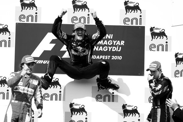 Race winner Mark Webber (AUS) Red Bull Racing celebrates on the podium with second placed Fernando Alonso (ESP) Ferrari (Left) and third placed Sebastian Vettel (GER) Red Bull Racing (Right). Formula One World Championship, Rd 12, Hungarian Grand Prix, Race, Budapest, Hungary, Sunday 1 August 2010.  Note: This image has been digitally altered from the original, which is also available on the archive. (d10hun1456.jpg)