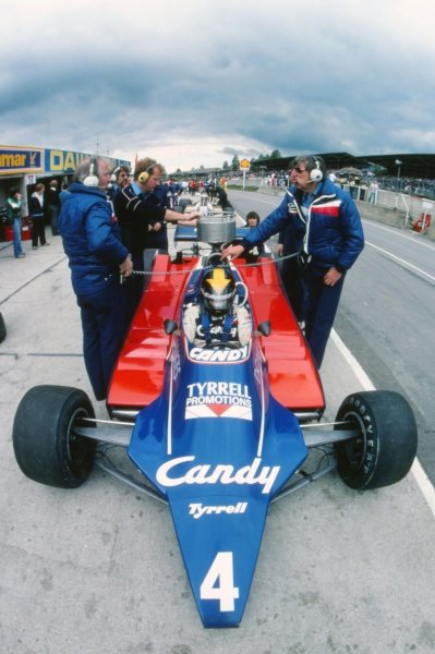 Ken Tyrrell (GBR) Tyrrell Team Owner (right) beside the car of Derek Daly (IRE) Tyrrell 010 in the pits. Formula One World Championship, Rd8, British Grand Prix, Brands Hatch, England, 13 July 1980. BEST IMAGE