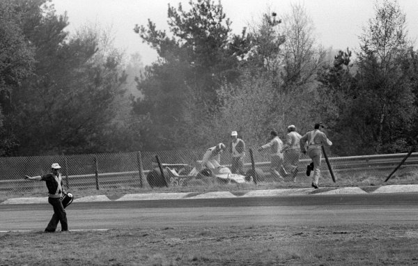 Patrick Depailler (FRA) climbs from his Ligier JS11 after crashing out from the lead of the race on lap 46.Belgian Grand Prix, Rd 6, Zolder, Belgium, 13 May 1979.