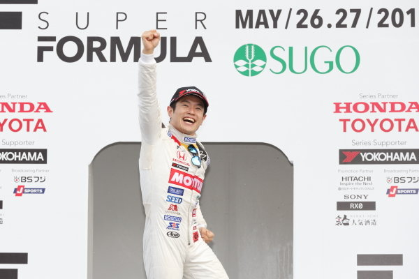Race winner Naoki Yamamoto, number 16 Team Mugen SF14 Honda, celebrates on the podium.